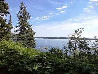 Kayaker-on-Jenny-Lake-GTNP-WY.jpg